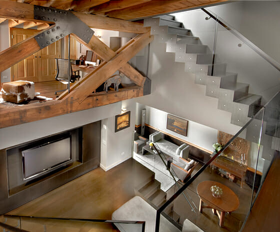 Contemporary Transformation Schoolhouse Loft, Featured Image, View from the second story platform to living area